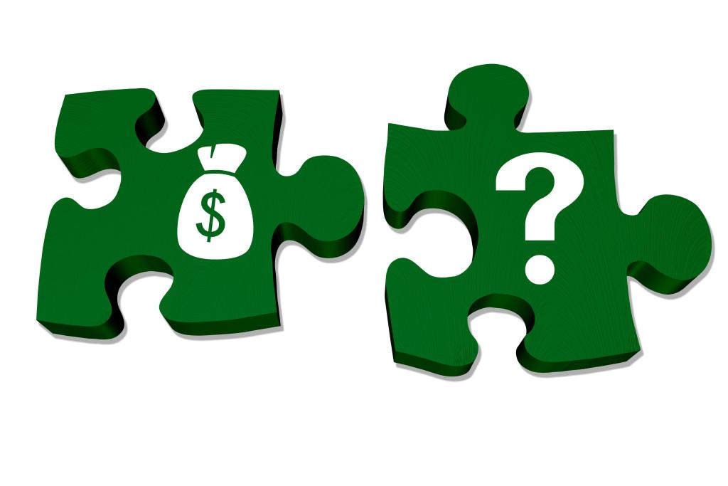 AdobeStock_money solutions puzzle